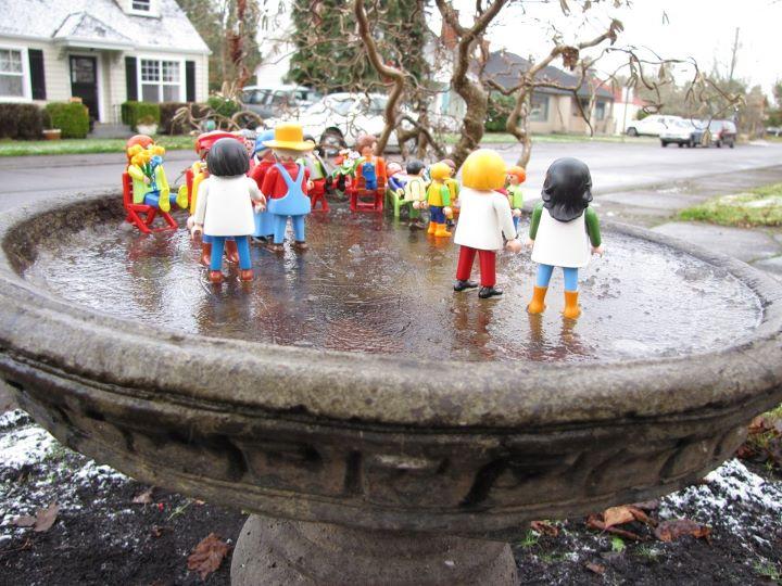 Playmobil figures on a frozen birdbath