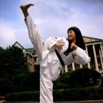 A black blet practices taekwondo