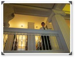 Pierce on a balcony
